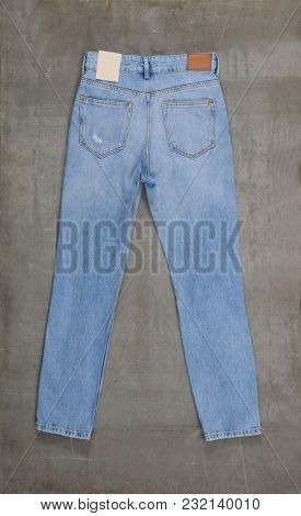 blue jeans isolated on gray background