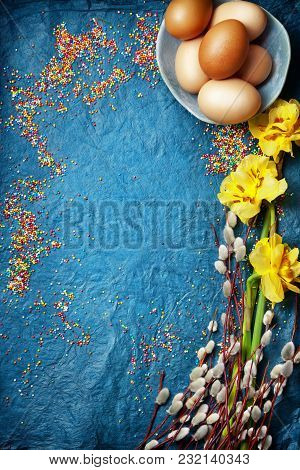Easter Empty Background With Easter Eggs And Spring Flowers. Top View With Copy Space.