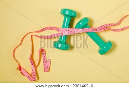 Meter Ribbon And Sports Bars. Concept Of Sport. Healthy Lifestyle...