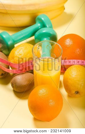 Orange Juice And A Meter Tape. Concept Of Healthy Eating. Sport