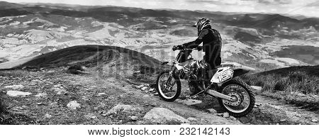 Carpathian Mountains In Ukraine.man Rides A Motorcycle In The Mountains. Mountain Range In Summer Gr