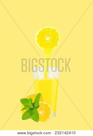 Glass Of Fresh Orange Juice With Oranges On Pastel Yellow Background