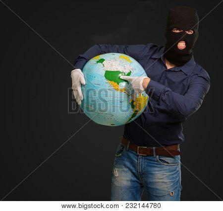 Burglar Man Holding Globe On Black Background