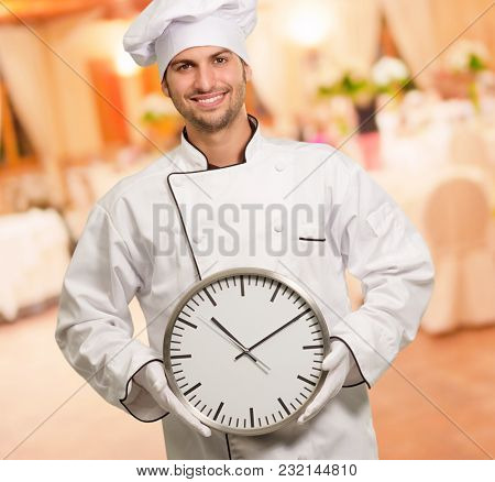 Male Chef Holding Wall Clock, Indoors