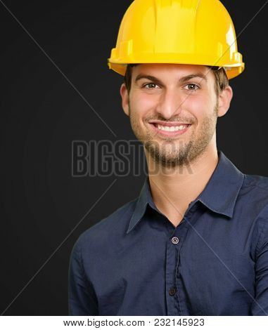 Portrait Of A Happy Architect Isolated On Black Background