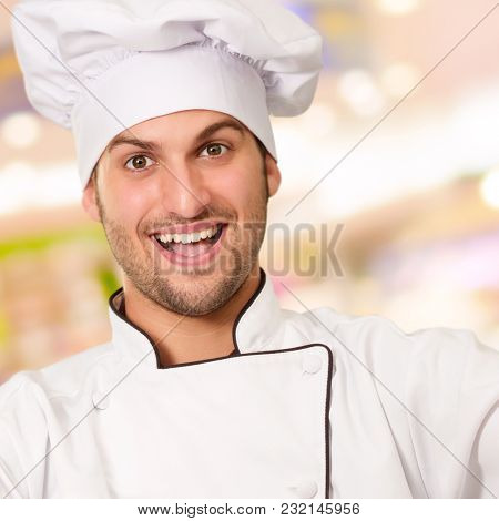 Portrait Of A Male Chef With Double Thumbs Up Sign, Indoors
