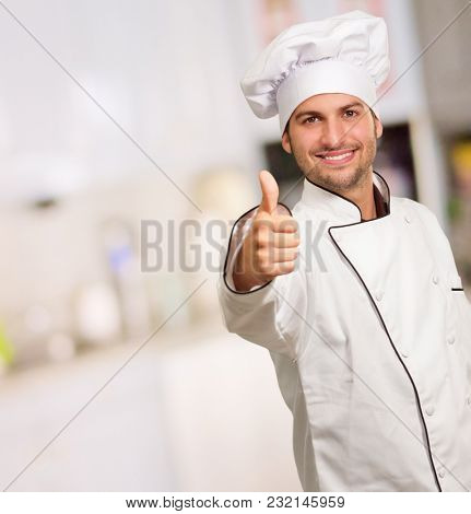 Male Chef Showing Thumbs Up Sign, Indoors