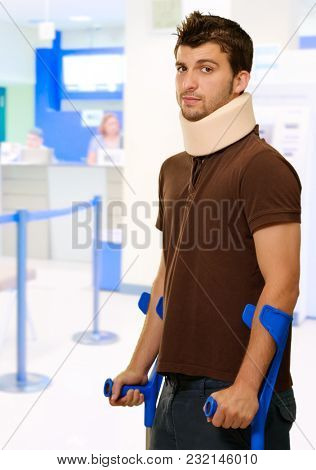 Man Walking On Crutches With Neck Brace, Indoor