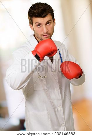 Young Doctor Wearing Boxing Gloves, Indoor