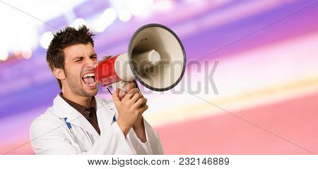 Male Doctor Shouting On Megaphone, Outdoors