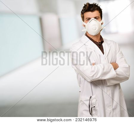 Young Doctor Wearing Mask With Hands Folded, Indoor