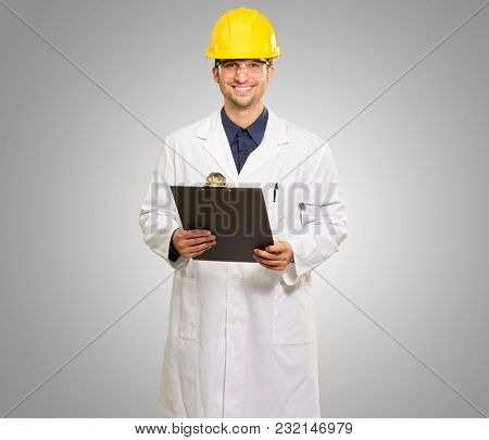 Happy Male Architect Holding Clipboard On Grey Background