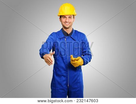 Young Engineer Offering Handshake Isolated On Grey Background