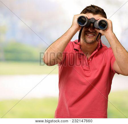 Young Man Holding Binoculars, Outdoor