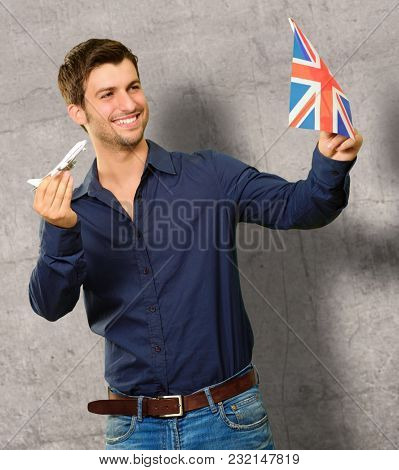 Young Man With British Flag And Aeroplane On Wall