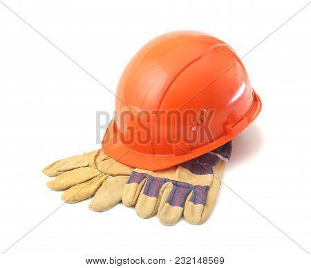 Orange Hard Hat, Safety Gloves On White Background. Safety Helmet