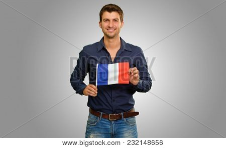 Young Man Holding France Flag Isolated On Grey Background