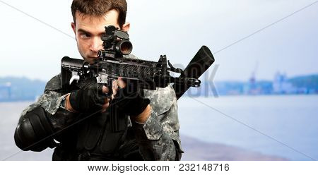 Portrait Of A Soldier Holding Gun at a port
