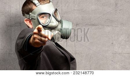 Businessman Pointing With Gas Mask against a grunge background