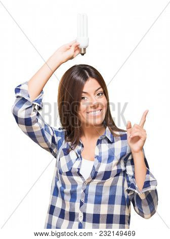 Young Woman Holding Bulb against a white background
