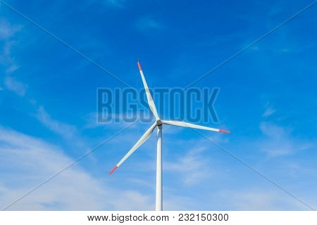 Rotating Windmill Generating Renewable Energy With Wind Power. Sustainability By Windmills Turbines