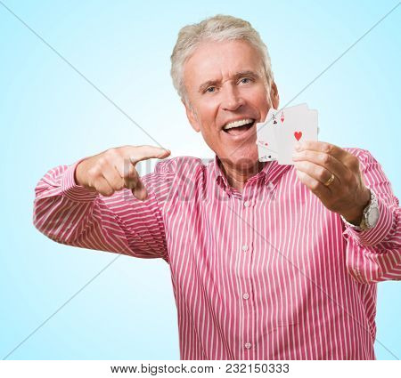 Mature Man Holding Playing Cards against a blue background
