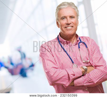 Portrait Of Male Doctor against an abstract background