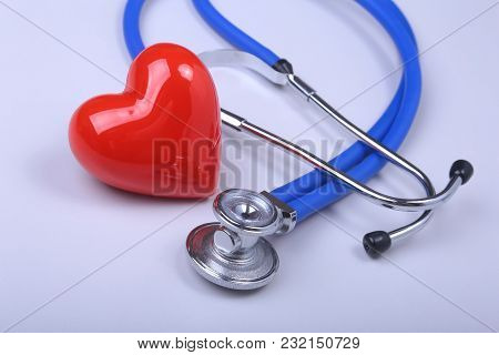 Stethoscope And Red Heart On White Table With Space For Text