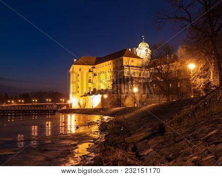 Illuminated Podebrady Castle At Labe River By Night, Czech Republic.