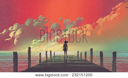 Beautiful Scenery Of The Woman Standing Alone On A Wooden Pier Looking At Colorful Clouds In The Sky