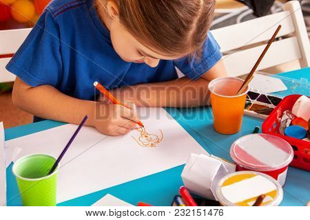 Small students painting in art school class. Child drawing by paints on table. Boy and girls in kindergarten. Girl dreams of enrolling in art school. Art children's school.