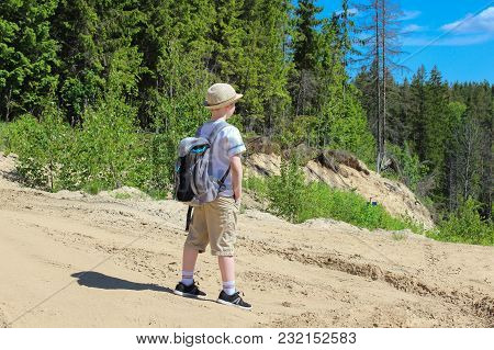 Traveller Boy With Backpack In The Forest In Summer
