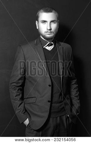 Serious Young Man In Suit.
