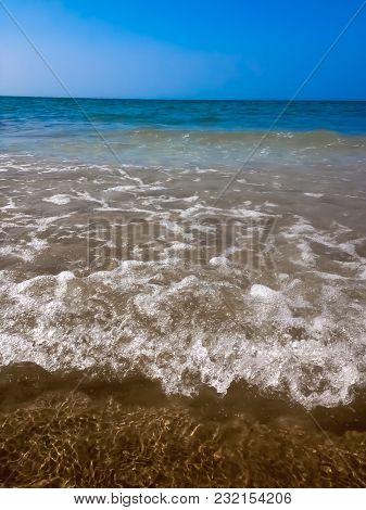 Surf Wave On A Sea Beach