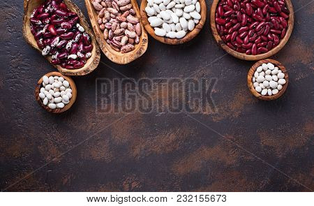 Different Type Of Beans In Wooden Bowls. Top View