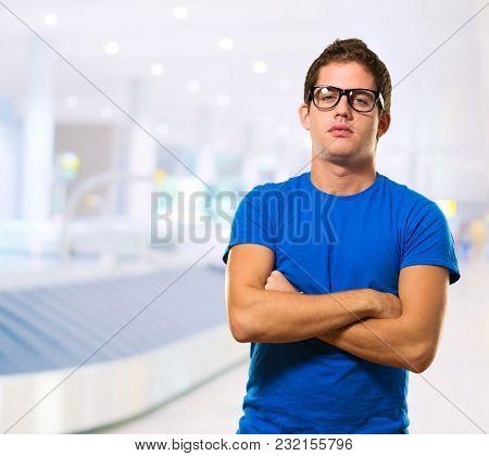 Young Man Wearing Eyeglasses at an airport
