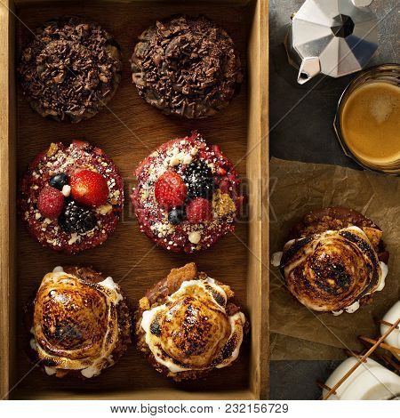 Variety Of Colorful Old Fashioned Fried Gourmet Donuts In A Wooden Box With Copy Space