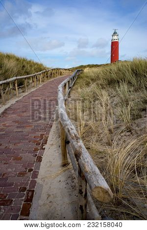 Red Lighthouse As A Tourist Attraction On Texel Island, The Netherlands