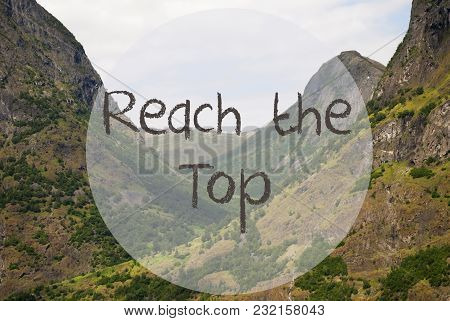 English Text Reach The Top. Valley With Mountains In Norway. Peaceful Landscape, Scenery With Grass,