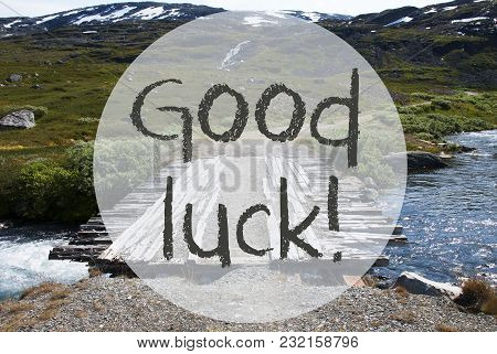 English Text Good Luck. Wooden Foot Bridge In Norway. Mountains And River For Beautiful Landscape Sc
