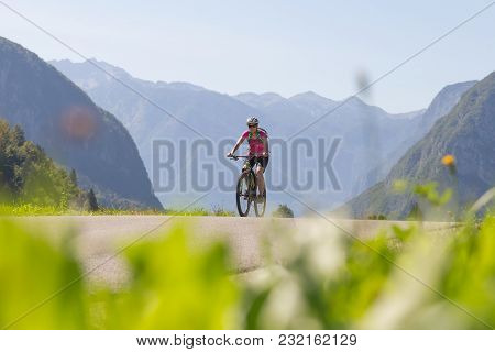 Active Sporty Woman Riding Mountain Bike In The Nature, Slovenia.