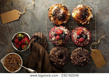 Variety Of Colorful Old Fashioned Fried Gourmet Donuts On A Cooling Rack With Copy Space