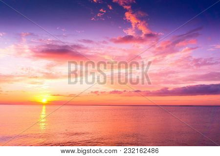 Sunset over Water Glowing Paradise
