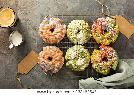 Variety Of Colorful Old Fashioned Fried Gourmet Donuts With Glaze On A Cooling Rack