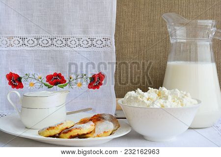 Still Life Of Dairy Products On A Background Of A Towel With Embroidery ..of Red Poppies. Cheesecake