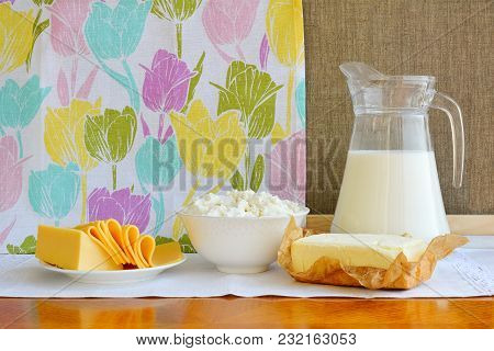 Still Life Of Dairy Products. Home Cottage Cheese, Milk In Jug, Cheese And Butter.
