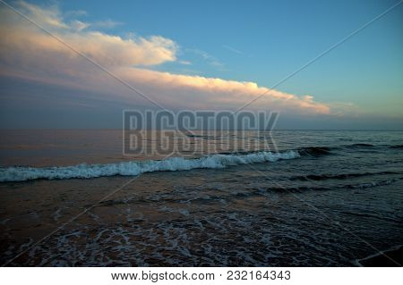 The Surf Going Out Along The Shoreline Coast Of The Atlantic Ocean In The Evening After Sunset