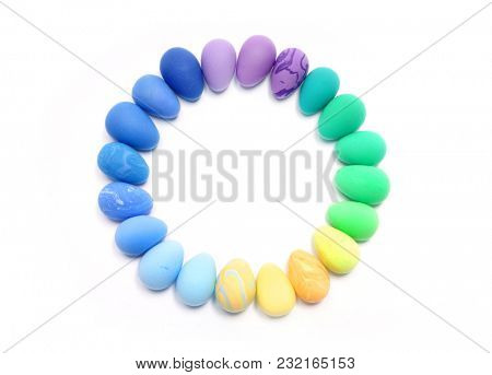 Easter. Abstraction from Plasticine. Easter decoration. Colored eggs on a white background