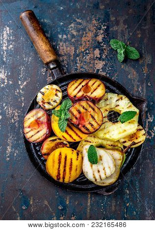 Grilled Fruits. Grill Fruits - Pineapple, Peaches, Plums, Avocado, Pear On Black Cast Iron Grill Pan