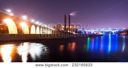 The Mississippi River Slowly Flows Under The Bridge At The St Paul Minnesota Waterfront